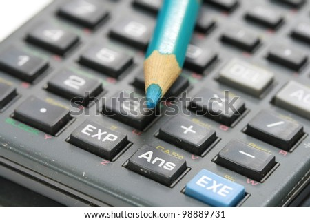 blue wooden pencil on calculator