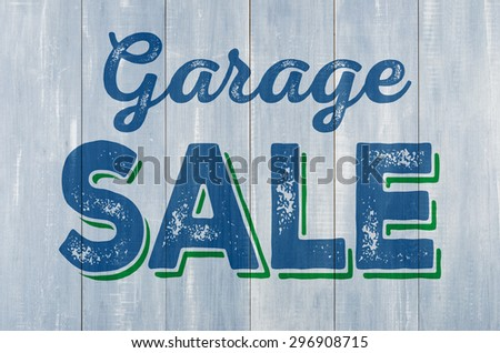 Blue wooden wall with the inscription Garage Sale - stock photo