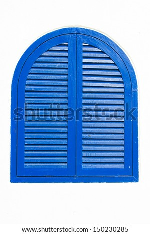 blue wooden window on white wall - stock photo