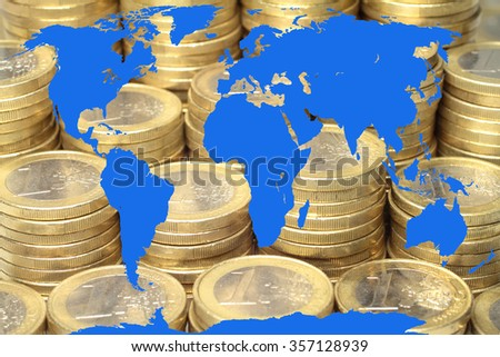 Blue world map with coins as a background. - stock photo
