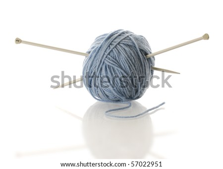 blue yarn with knitting needles with reflection on white background - stock photo
