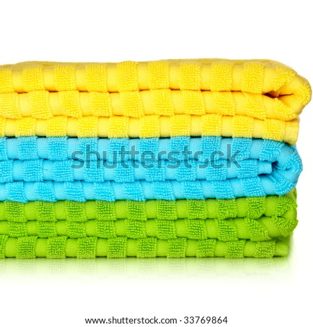 Blue, Yellow and Green Beach Towels Isolated On White Background - stock photo