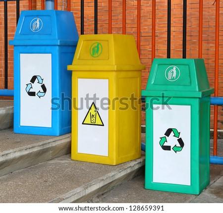 blue yellow and green garbage bin - stock photo