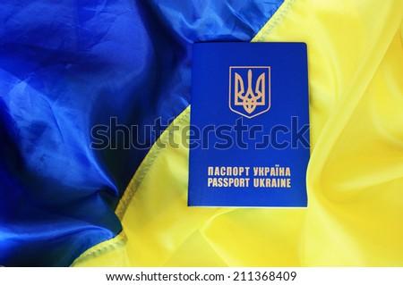 blue yellow flag and passport of Ukraine - stock photo