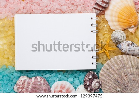 blue yellow pink bath salt and blank notepad background
