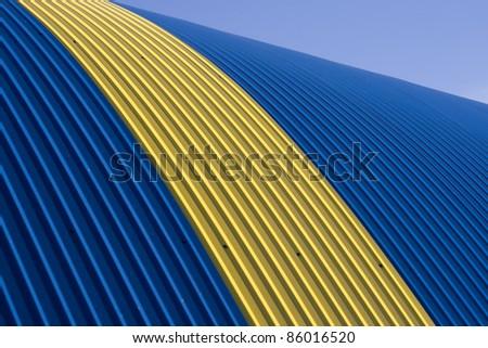 Blue - yellow tin roof - stock photo