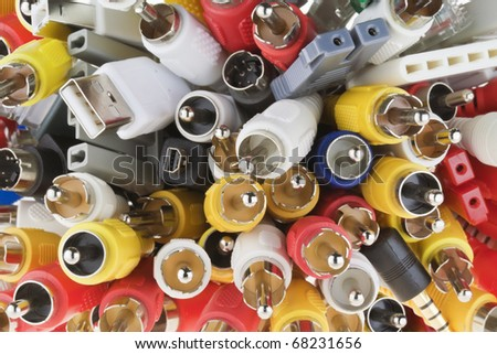 Blue, yellow, white, red,  gray digital connectors for  modern video audio  equipment macro background - stock photo