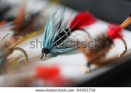 Blue Zulu - Artificial fly used for trout fishing - stock photo