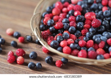 Blueberries and strawberries in a wicker plate