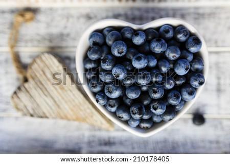 Blueberries - fresh blueberries in bowl - stock photo