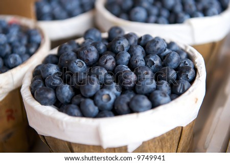 Blueberries in a basket on a market stall - stock photo