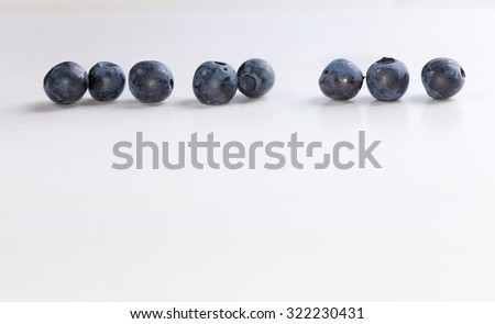 blueberries in a row, copy space - stock photo