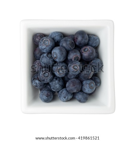 Blueberries in a square bowl isolated on white background - stock photo