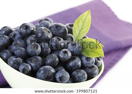 Blueberries in plastic bowl - stock photo