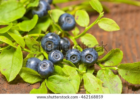 blueberries in the detail on a wooden table