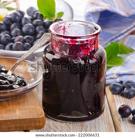 Blueberries jam  on  wooden table. Selective focus - stock photo