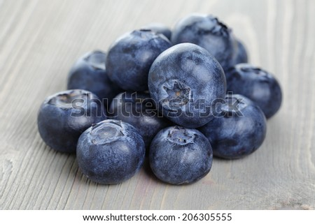 blueberries on old wood table, selective focus