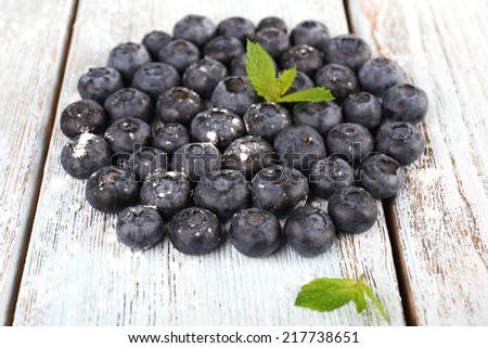 Blueberries on wooden background closeup