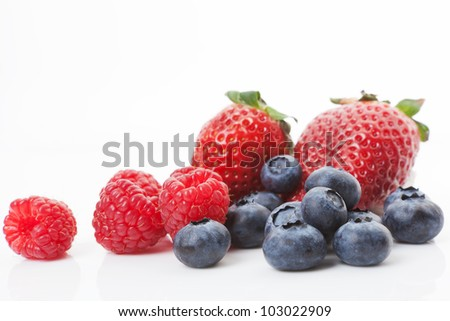 Blueberries, raspberries and strawberries isolated on white background. Sweet summer fruits. - stock photo