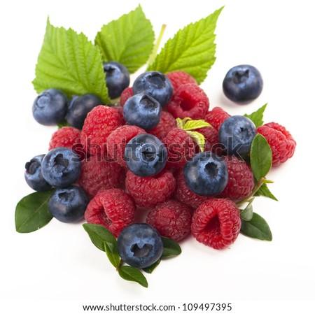 blueberries , raspberries on white background - stock photo