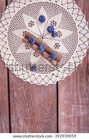 blueberries with cinnamon on a lacy napkin