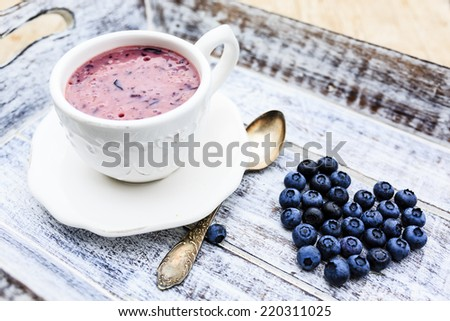 Blueberries with yogurt - stock photo