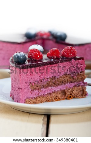 blueberry and raspberry cake mousse dessert with spice  - stock photo