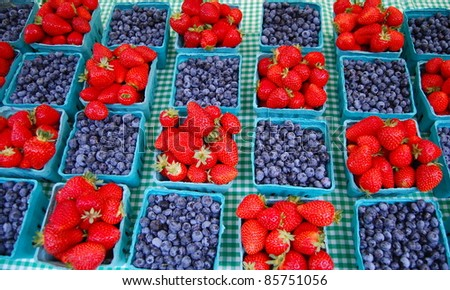 Blueberry and Strawberry Checkerboard on Picnic Table - stock photo