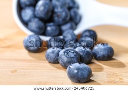 Blueberry antioxidant organic superfood on a spoon concept for healthy eating and nutrition selective focus - stock photo