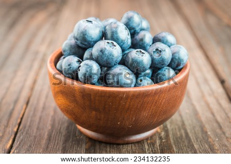 Blueberry bowl on wooden background - vintage effect style pictures - stock photo