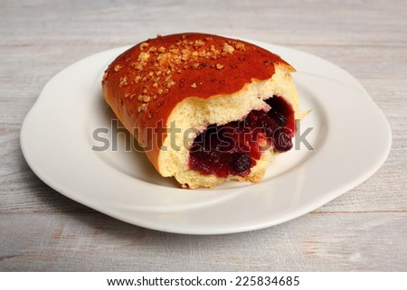 Blueberry Bun. Bun made from yeast dough, filled with bilberries, delicately covered with crumble.