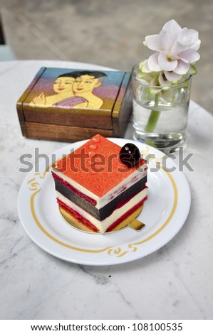blueberry cake on marble table with beautiful flower