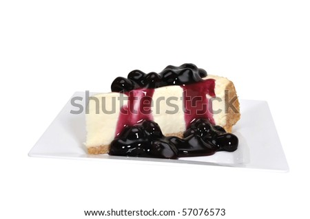 Blueberry cheesecake isolated on white background with clipping path. - stock photo