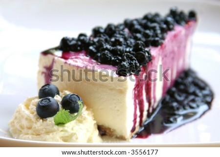 Blueberry cheesecake slice - stock photo