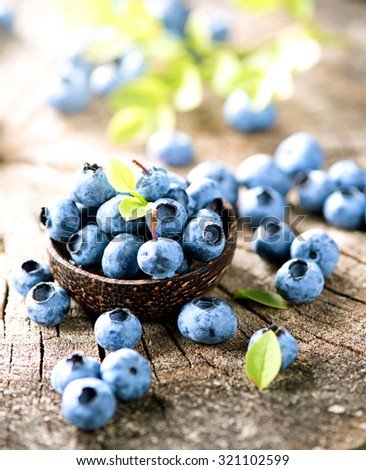 Blueberry closeup. Freshly picked blueberries in wooden bowl over rustic background. Juicy and fresh berries. Bilberries on wooden table. Diet, dieting. Healthy food concept. Vitamins and antioxidants - stock photo