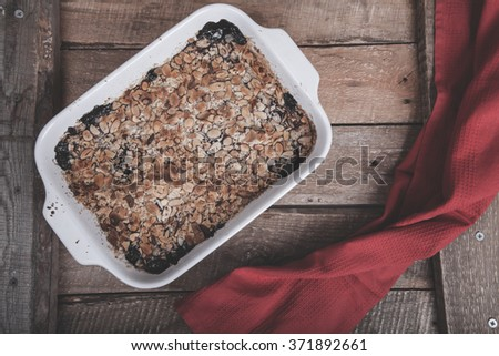 blueberry crumble on a wooden background