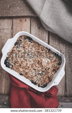 blueberry crumble on a wooden background - stock photo