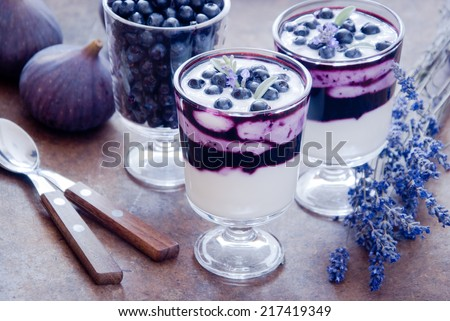 Blueberry dessert with lavender flowers - stock photo