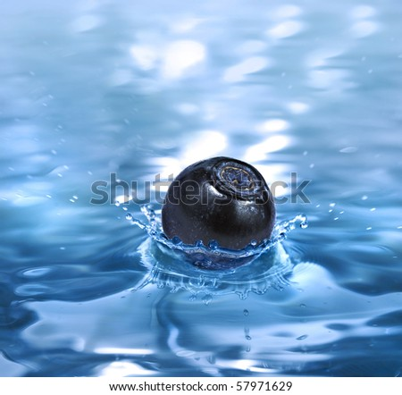 blueberry falling in a refreshing drink - stock photo