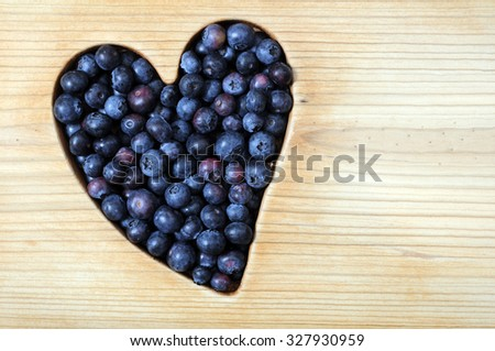 blueberry fruit with heart shape for health concept