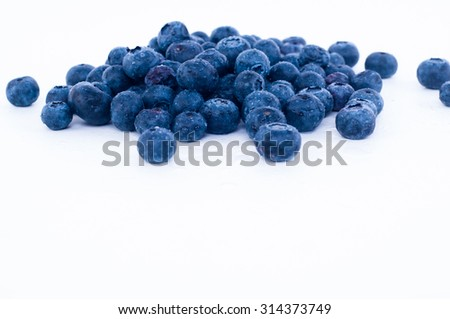blueberry fruit with white background  (shallow depth of field) - stock photo