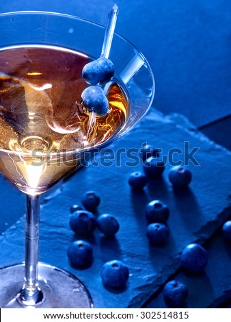 Blueberry gold drink on black background. Cocktail card 81