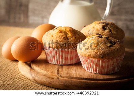 Blueberry home made muffins with cooking ingredients, eggs, milk, flour and fresh berries. Healthy breakfast concept of baked cupcakes. - stock photo