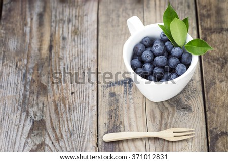 Blueberry in cup - stock photo