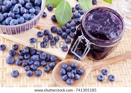 Blueberry jam and fresh fruits on the kitchen table