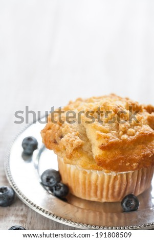 Blueberry muffin breakfast with blueberries on silver antique plate - stock photo