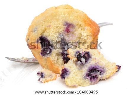 blueberry muffin with fork white background - stock photo