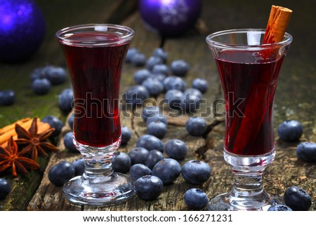 Blueberry mulled wine with cinnamon - stock photo