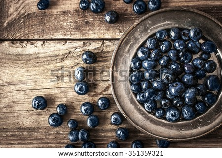 Blueberry on the vintage plate horizontal