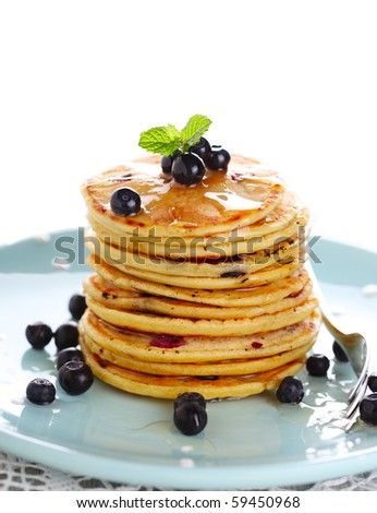 Blueberry pancakes with fresh blueberries - stock photo